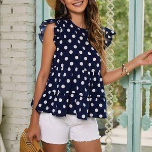 Blue and white polka dot ruffle hem peplum blouse
